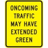 Oncoming Traffic May Have Extended Green Sign
