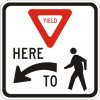 Yield to Pedestrians Here Sign