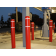 Red bollard covers with white tape around gas pumps